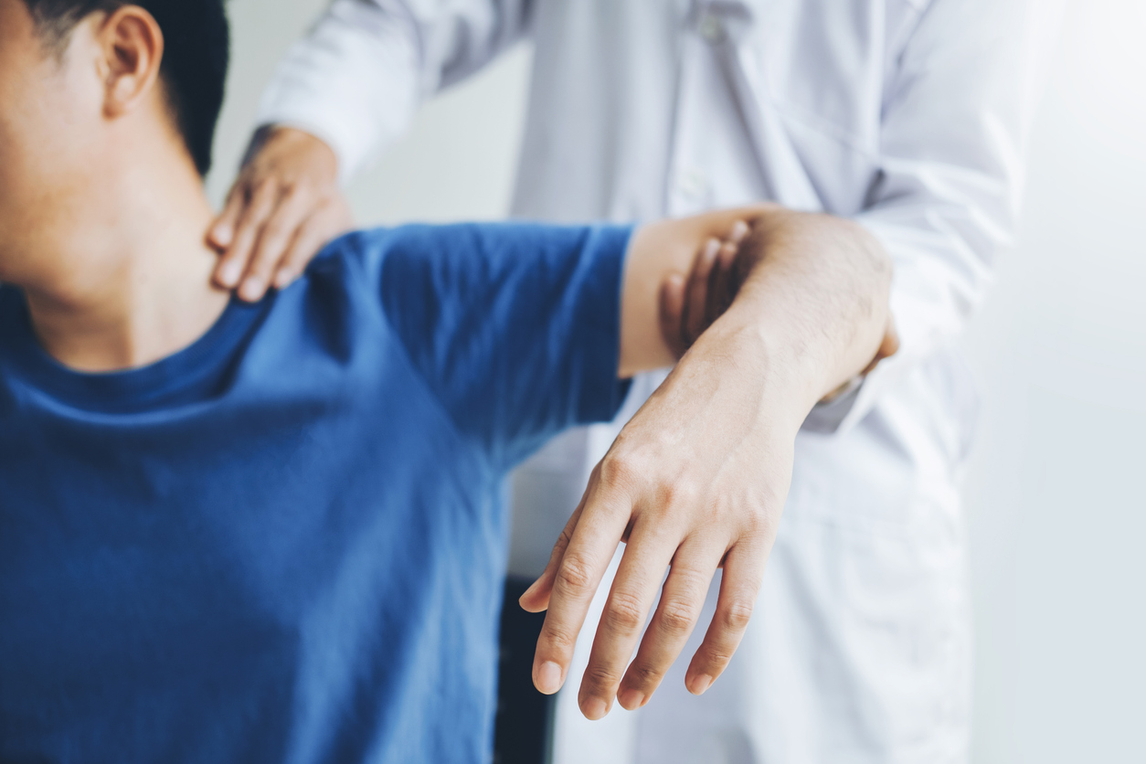 male patient receiving chiropractor care